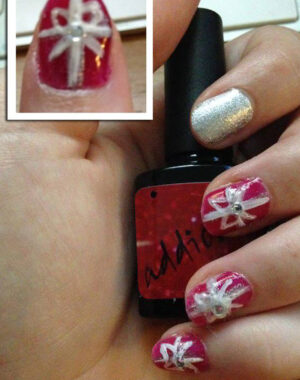 Red and Silver Christmas Present Nails Feature Image