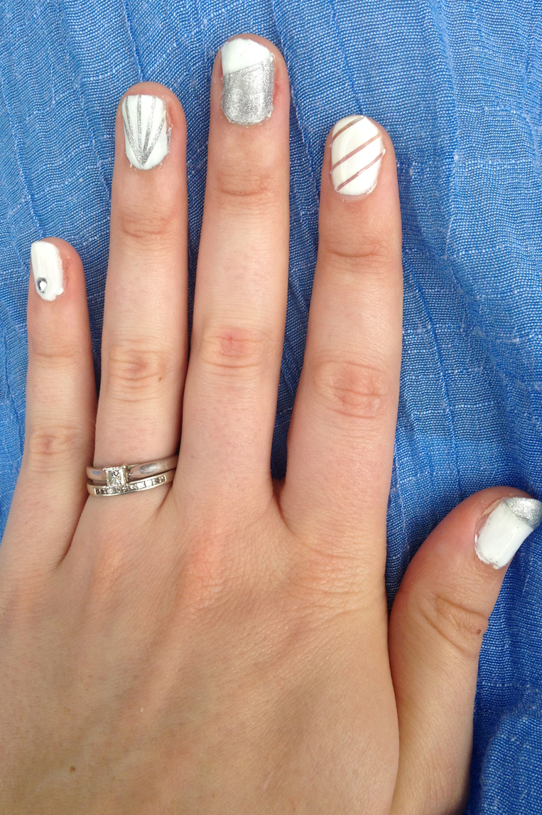 Easy, simple and classy silver and white nails manicure done with stripping tape.