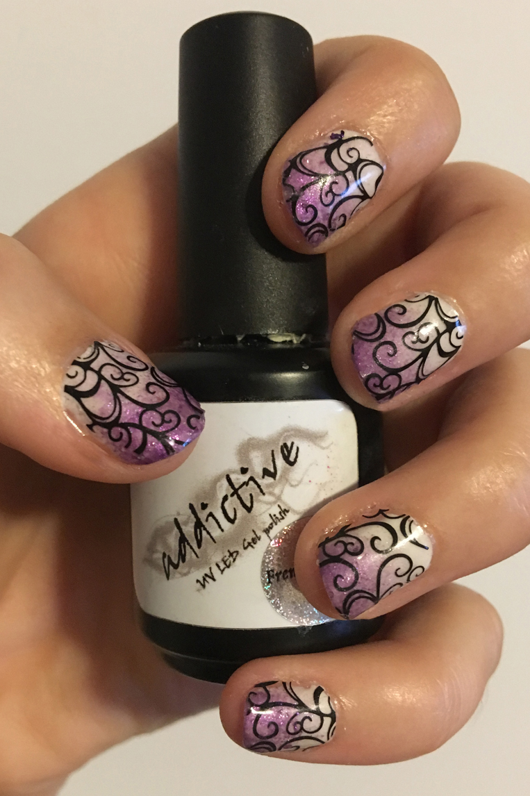 Check out my latest nail art creation, purple ombre nails with swirl nail stickers. A totally easy nail art idea for an awesome everyday look or a classy special occasion. Details about my new LED Nail Art lamp included as well.