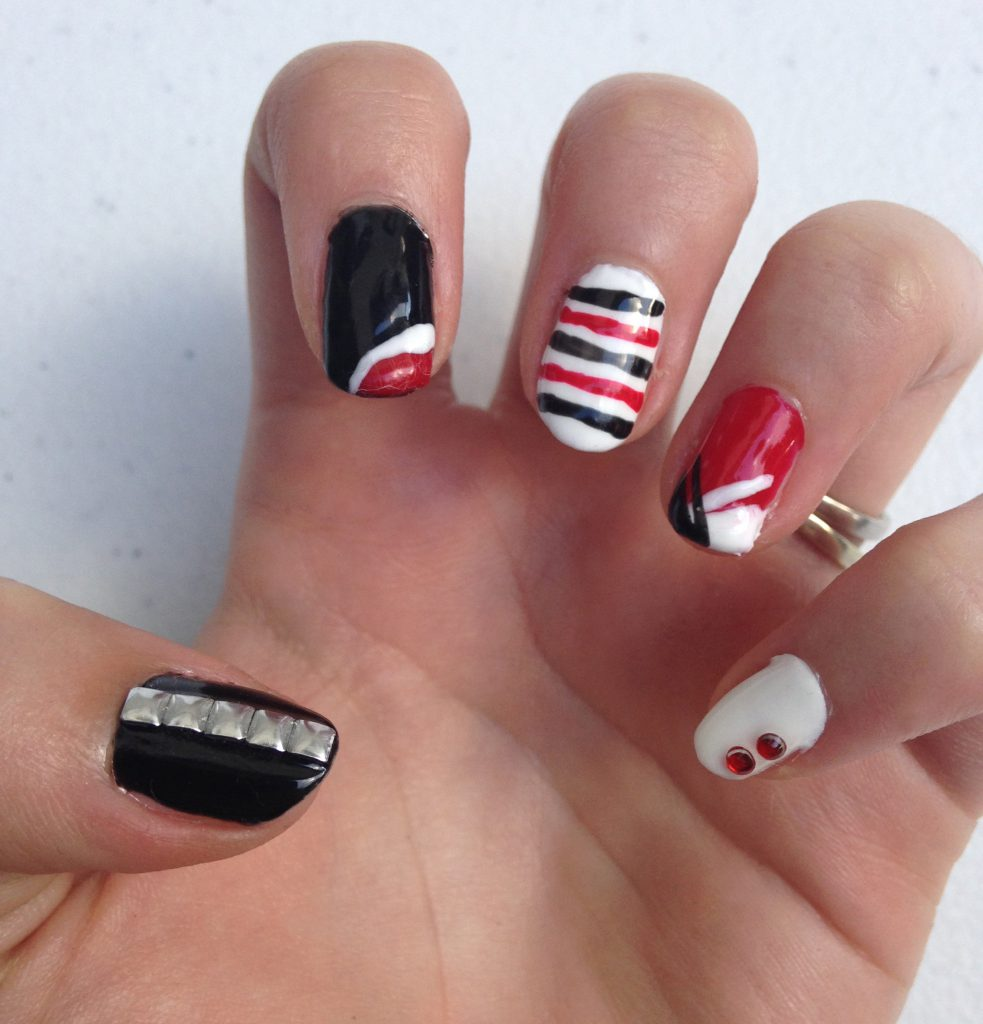black  red and white geometric nails